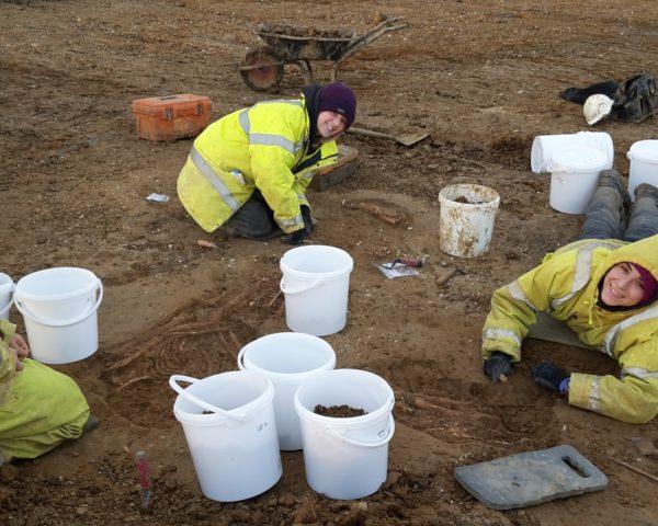 Archaeologists Joe Locke, Frances Bradbury and Diana De León Subias(L to R) excavate and record three Roman inhumation graves in Milton Keynes