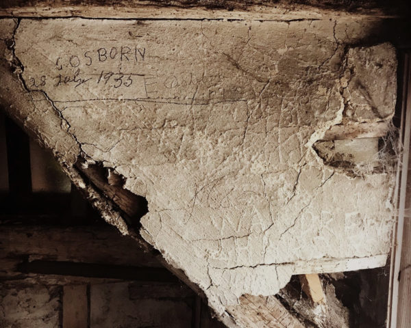 name scratched in plaster of listed building